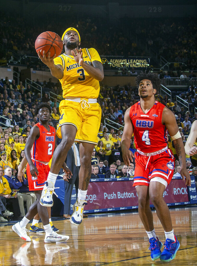 Livers scores 24, Michigan routs Houston Baptist, 111-68