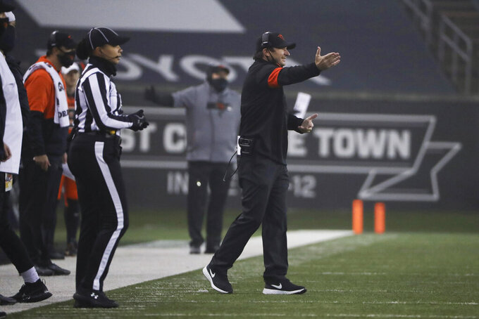 Oregon State coach Jonathan Smith calls out to players during the first half of the team's NCAA college football game against Oregon in Corvallis, Ore., Friday, Nov. 27, 2020. (AP Photo/Amanda Loman)