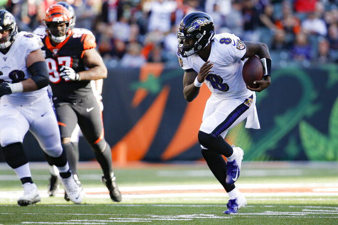 Baltimore Ravens quarterback Lamar Jackson (8) runs the ball for a touchdown during the second half of NFL football game against the Cincinnati Bengals, Sunday, Nov. 10, 2019, in Cincinnati. (AP Photo/Frank Victores)