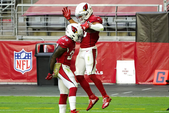 Arizona Cardinals wide receiver Christian Kirk celebrates his touchdown with running back Chase Edmonds (29) during the first half of an NFL football game against the Miami Dolphins, Sunday, Nov. 8, 2020, in Glendale, Ariz. (AP Photo/Rick Scuteri)