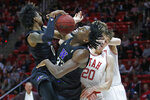 Washington's Jaden McDaniels (0) and Isaiah Stewart (33) battle against Utah forward Mikael Jantunen (20) for a rebound in the first half during an NCAA college basketball game Thursday, Jan. 23, 2020, in Salt Lake City. (AP Photo/Rick Bowmer)