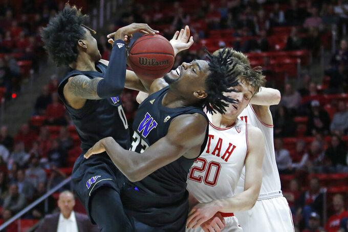 Washington's Jaden McDaniels (0) and Isaiah Stewart (33) battle against Utah forward Mikael Jantunen (20) for a rebound in the first half during an NCAA college basketball game Thursday, Jan. 23, 2020, in Salt Lake City. (AP Photo/Rick Bowmer)