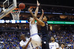 Butler forward Jordan Tucker (1) shoots with Seton Hall forward Sandro Mamukelashvili (23) defending during the first half of an NCAA college basketball game Wednesday, Feb. 19, 2020, in Newark, N.J. (AP Photo/Kathy Willens)