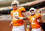 Tennessee quarterbacks Brian Maurer (18) and Jarrett Guarantano (2) take the field for warmups before a NCAA football game against University of Tennessee at Chattanooga at Neyland Stadium on Saturday, Sept. 14, 2019 in Knoxville, Tenn.(C.B. Schmelter/Chattanooga Times Free Press via AP)