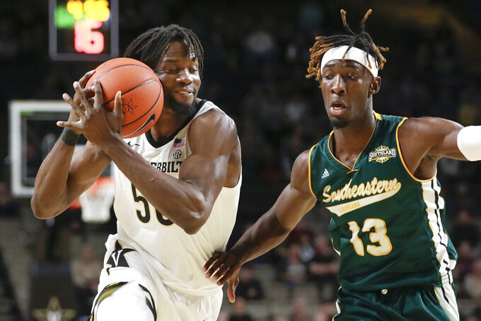 Vanderbilt forward Ejike Obinna (50) drives against Southeastern Louisiana forward Pape Diop (13) in the first half of an NCAA college basketball game Monday, Nov. 25, 2019, in Nashville, Tenn. (AP Photo/Mark Humphrey)