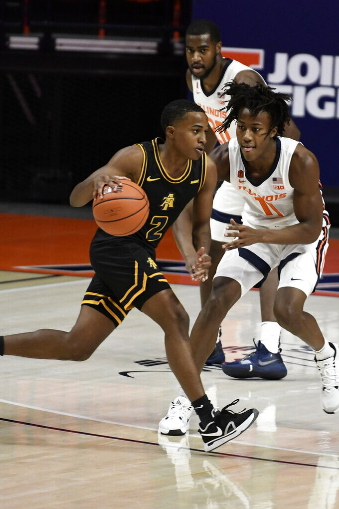 North Carolina A&T's Fred Cleveland, Jr. drives the ball as Illinois' Ayo Dosunmu (11) and Da'Monte (20) defend in the first half of an NCAA college basketball game Wednesday, Nov. 25, 2020, in Champaign, Ill. (Photo/Holly Hart)