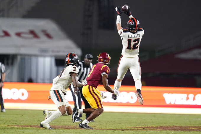 Oregon State linebacker Jack Colletto (12) jumps in front of Southern California wide receiver Gary Bryant Jr. (1) to intercept a pass during the second half of an NCAA college football game Saturday, Sept. 25, 2021, in Los Angeles. (AP Photo/Marcio Jose Sanchez)