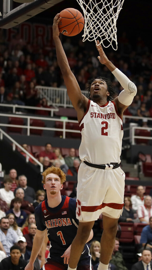 Stanford's Bryce Wills (2) shoots in front of Arizona's Nico Mannion during the first half of an NCAA college basketball game Saturday, Feb. 15, 2020, in Stanford, Calif. (AP Photo/Ben Margot)