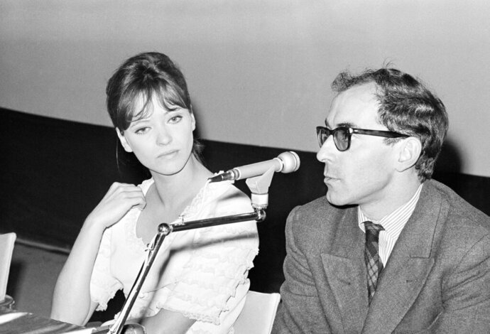 FILE - In this Aug. 31, 1965, file photo, French movie director Jean Luc Godard and French actress Anna Karina are shown at the International Film Festival in Venice. Anna Karina, the French New Wave actress who became an icon of the cinema in the 1960s and was the muse of Jean-Luc Godard, has died aged 79, the French culture minister announced Sunday Dec. 15, 2019. (AP Photo/Mario Torrisi, File)