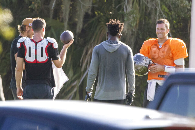Tampa Bay Buccaneers NFL football quarterback Tom Brady, far right, is seen along with other players during a private workout Tuesday, June 23, 2020, at Berkeley Preparatory School in Tampa, Fla. (Chris Urso/Tampa Bay Times via AP)