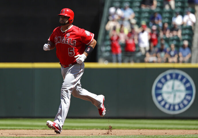 Los Angeles Angels' Albert Pujols rounds the bases on a solo home run against the Seattle Mariners in the second inning of a baseball game Sunday, July 21, 2019, in Seattle. (AP Photo/Elaine Thompson)