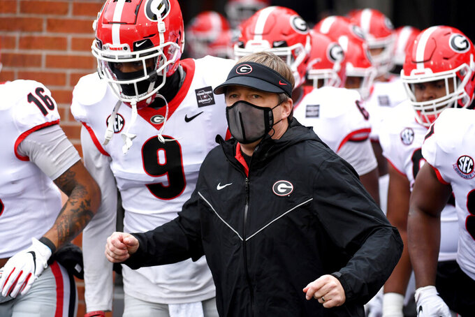 "Georgia head coach Kirby Smart is seen before the start of an NCAA college football game against Missouri Saturday, Dec. 12, 2020, in Columbia, Mo.  The personal touch that helps coaches sell their programs to blue-chip prospects is missing from this year's recruiting cycle. Restrictions brought about by the coronavirus pandemic prevent face-to-face communication between players and coaches. Staffs can't visit high schools. Plenty of states aren't even playing high school football. ""It's just weird,"" Georgia coach Kirby Smart said.(AP Photo/L.G. Patterson)"