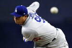 Los Angeles Dodgers starting pitcher Hyun-Jin Ryu, of South Korea, works against a San Diego Padres batter during the first inning of a baseball game, Monday, April 16, 2018, in San Diego. (AP Photo/Gregory Bull)