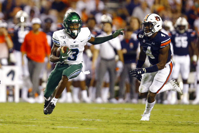 Tulane wide receiver Darnell Mooney (3) gets away from Auburn defensive back Noah Igbinoghene (4) after a reception during the second quarter of an NCAA college football game Saturday, Sept. 7, 2019, in Auburn, Ala. (AP Photo/Butch Dill)