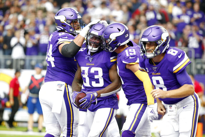 Minnesota Vikings running back Dalvin Cook (33) celebrates with teammates after a 19-yard touchdown run during the first half of an NFL football game against the Atlanta Falcons, Sunday, Sept. 8, 2019, in Minneapolis. (AP Photo/Bruce Kluckhohn)