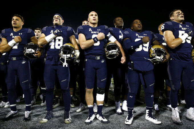 "Navy quarterback Zach Abey, center, sings ""Navy Blue and Gold"" alongside teammates after an NCAA college football game against Tulsa, Saturday, Nov. 17, 2018, in Annapolis, Md. Navy won 37-29. (AP Photo/Patrick Semansky)"