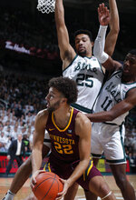 Minnesota's Gabe Kalscheur (22) is pressured by Michigan State's Kenny Goins (25) and Aaron Henry (11) during the first half of an NCAA college basketball game, Saturday, Feb. 9, 2019, in East Lansing, Mich. (AP Photo/Al Goldis)