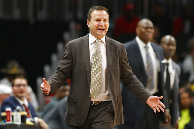 """FILE - In this Jan. 26, 2020, file photo, Washington Wizards head coach Scott Brooks reacts during the second half of an NBA basketball game against the Atlanta Hawks in Atlanta. It is hard to know exactly what Washington is capable of becoming as it moves forward, and much will depend on how this offseason unfolds. """"We have some decisions to make,"""" Brooks said. (AP Photo/Todd Kirkland, File)"""