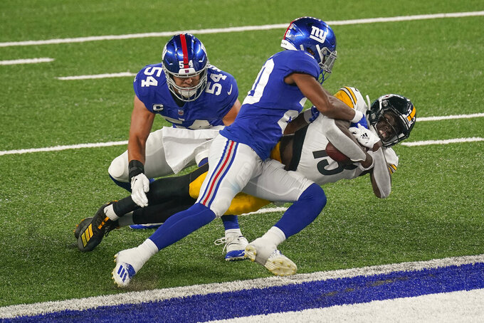 Pittsburgh Steelers wide receiver James Washington (13) pushes past New York Giants cornerback Julian Love (20) and inside linebacker Blake Martinez (54) to cross the goal line for a touchdown during the second quarter of an NFL football game Monday, Sept. 14, 2020, in East Rutherford, N.J. (AP Photo/Seth Wenig)
