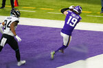 Minnesota Vikings wide receiver Adam Thielen (19) catches a 3-yard touchdown pass ahead of Jacksonville Jaguars cornerback Greg Mabin, left, during the first half of an NFL football game, Sunday, Dec. 6, 2020, in Minneapolis. (AP Photo/Jim Mone)