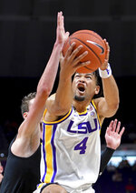 LSU guard Skylar Mays (4) grimaces while driving to the basket past UMBC guard Brandon Horvath during the first half of an NCAA college basketball game Tuesday, Nov. 19, 2019, in Baton Rouge, La. (AP Photo/Bill Feig)