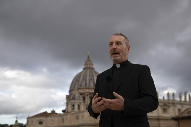 In this Monday, Dec. 9, 2019 photo, Monsignor John Kennedy, the head of the Congregation for the Doctrine of the Faith discipline section, speaks during an interview on the terrace of the section's offices at the Vatican.