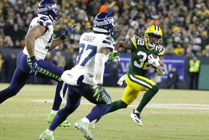 Green Bay Packers' Tyler Ervin runs during the first half of an NFL divisional playoff football game against the Seattle Seahawks Sunday, Jan. 12, 2020, in Green Bay, Wis. (AP Photo/Mike Roemer)