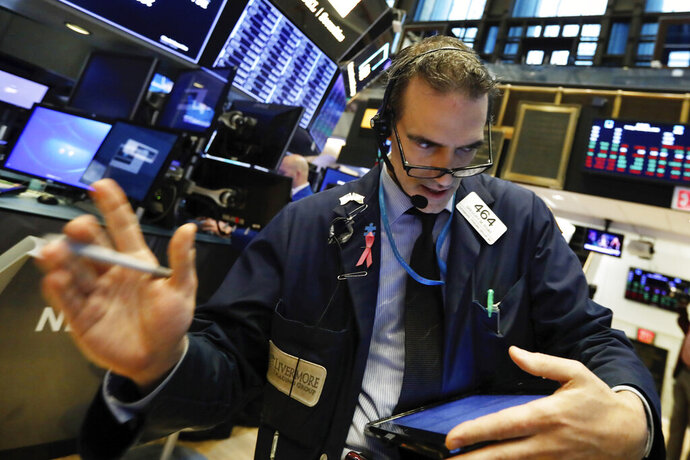 Trader Gregory Rowe works on the floor of the New York Stock Exchange, Friday, Feb. 8, 2019. Stocks are opening lower on Wall Street as a mixed bag of earnings reports didn't inspire investors to get back to buying stocks. (AP Photo/Richard Drew)