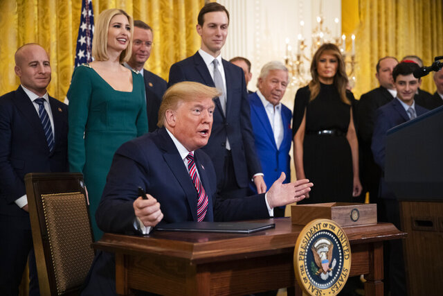 President Donald Trump gestures before signing an executive order targeting what his administration says is growing anti-Semitism on U.S. college campuses during a Hanukkah reception in the East Room of the White House in Washington on Wednesday, Dec. 11, 2019. (AP Photo/Manuel Balce Ceneta)