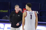 Gonzaga coach Mark Few speaks with guard Jalen Suggs during the second half of the team's NCAA college basketball game against Northwestern State in Spokane, Wash., Tuesday, Dec. 22, 2020. Gonzaga won 95-78. (AP Photo/Young Kwak)