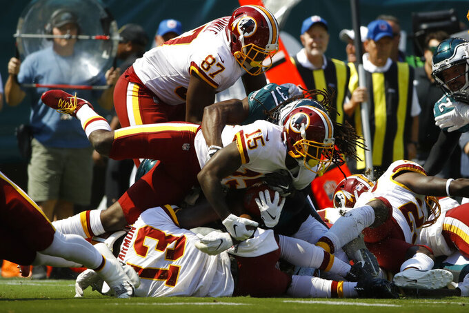 Washington Redskins' Steven Sims (15) is tackled by Philadelphia Eagles' Johnathan Cyprien (37) after returning a kick during the first half of an NFL football game against the Philadelphia Eagles, Sunday, Sept. 8, 2019, in Philadelphia. (AP Photo/Matt Rourke)