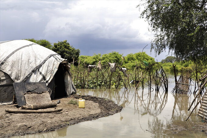 Flooding surrounds a house in Lenyari in the Greater Pibor Administrative Area, South Sudan Thursday, Sept. 10, 2020. Flooding has affected well over a million people across East Africa, another calamity threatening food security on top of a historic locust outbreak and the coronavirus pandemic. (Tetiana Gaviuk/Medecins Sans Frontieres via AP)