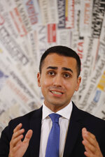 Deputy Premier and Labor Minister Luigi Di Maio talks to reporters during a press conference at the Foreign Press Association headquarters, in Rome, Friday, Nov. 9, 2018. (AP Photo/Andrew Medichini)