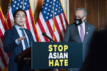 Rep. Andy Kim, D-N.J., accompanied by Senate Majority Leader Chuck Schumer, D-N.Y., speaks during a news conference on Capitol Hill, in Washington, Tuesday, April 13, 2021. (AP Photo/Jose Luis Magana)