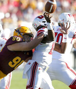 Arizona State defensive lineman Jermayne Lole (90) forces a fumble on Utah quarterback Jason Shelley (15) in the second half during an NCAA college football game, Saturday, Nov. 3, 2018, in Tempe, Ariz. (AP Photo/Rick Scuteri)