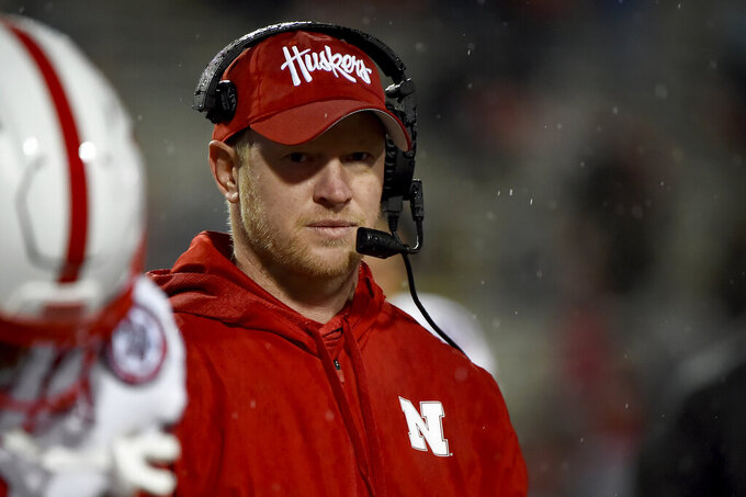 FILE - In this Nov. 23, 2019, file photo, Nebraska head coach Scott Frost looks on during the second half of an NCAA college football game against Maryland in College Park, Md. It has been a slow build for Frost at Nebraska. The Cornhuskers are 9-15 in his first two seasons, including just 4-8 against Big Ten West opponents and only two road wins. (AP Photo/Will Newton, File)