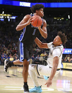 Duke forward Vernon Carey Jr. knocks Georgia Tech defender forward James Banks III to the hardwood during the second half of an NCAA college basketball game Wednesday, Jan. 8, 2020, in Atlanta. (Curtis Compton/Atlanta Journal-Constitution via AP)