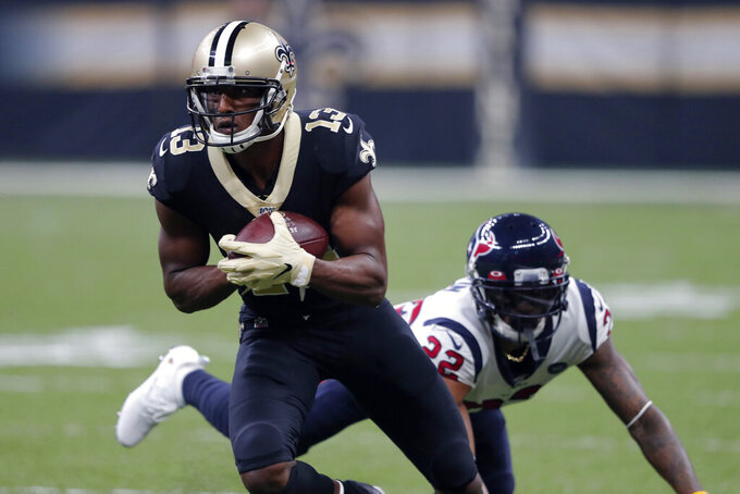New Orleans Saints wide receiver Michael Thomas (13) carries past Houston Texans cornerback Aaron Colvin (22) on a a reception in the first half of an NFL football game in New Orleans, Monday, Sept. 9, 2019. (AP Photo/Bill Feig)