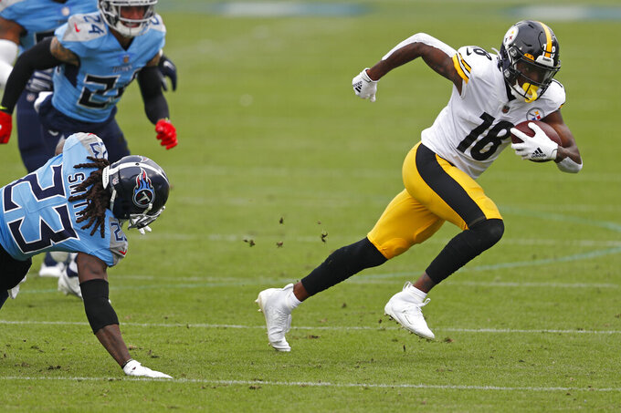 Pittsburgh Steelers wide receiver Diontae Johnson (18) gets past Tennessee Titans cornerback Tye Smith (23) in the first half of an NFL football game Sunday, Oct. 25, 2020, in Nashville, Tenn. (AP Photo/Wade Payne)