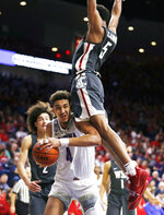 Arizona center Chase Jeter (4) is fouled by Washington State forward Marvin Cannon during the second half during an NCAA college basketball game Saturday, Feb. 9, 2019, in Tucson, Ariz. Washington State defeated Arizona 69-55. (AP Photo/Rick Scuteri)