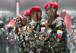 In this Friday July 5, 2019 photo, soldiers march during a military parade marking Independence Day in Caracas. Venezuela is marking 208 years of their declaration of independence from Spain. (AP Photos/Ariana Cubillos)