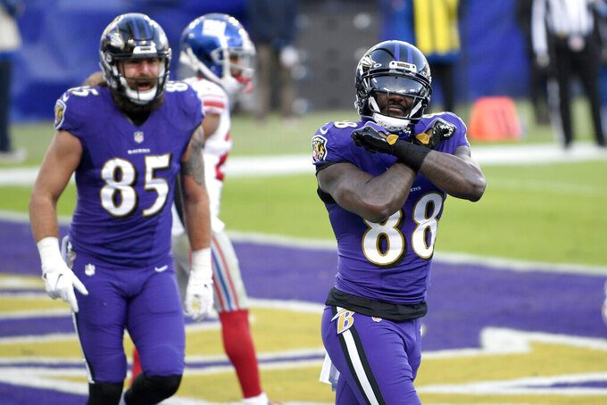 Baltimore Ravens wide receiver Dez Bryant (88) reacts after catching a touchdown pass from quarterback Lamar Jackson, not visible, against the New York Giants during the second half of an NFL football game, Sunday, Dec. 27, 2020, in Baltimore. (AP Photo/Nick Wass)