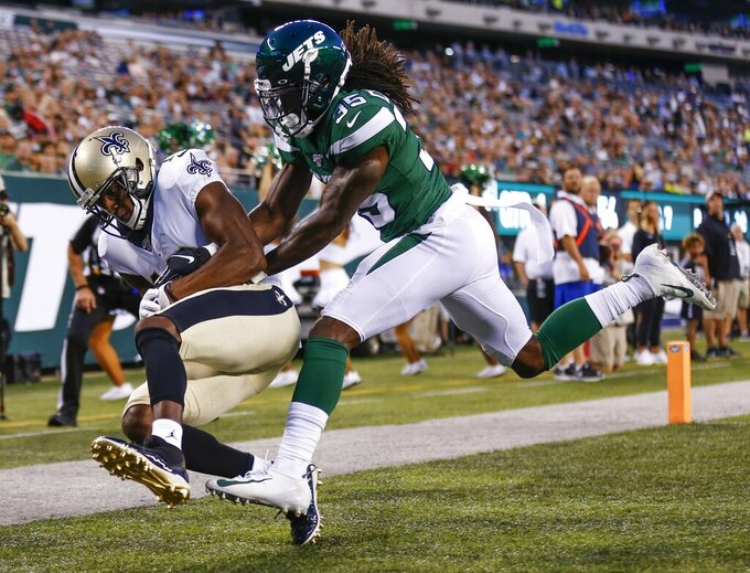 New Orleans Saints' Michael Thomas (13) catches a pass for a touchdown in front of New York Jets' Tevaughn Campbell (35) during the first half of a preseason NFL football game Saturday, Aug. 24, 2019, in East Rutherford, N.J. (AP Photo/Adam Hunger)
