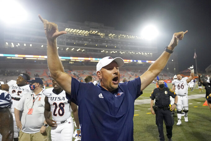 UTSA head coach Jeff Taylor celebrates his team's win over Illinois after an NCAA college football game Saturday, Sept. 4, 2021, in Champaign, Ill. (AP Photo/Charles Rex Arbogast)