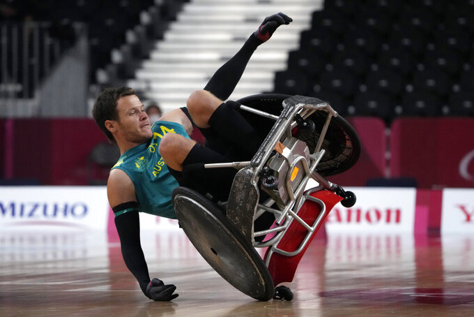 Australia's Andrew Edmondson falls during a semifinal wheelchair rugby match against the United States at the Tokyo 2020 Paralympic Games, Saturday, Aug. 28, 2021, in Tokyo, Japan. (AP Photo/Kiichiro Sato)
