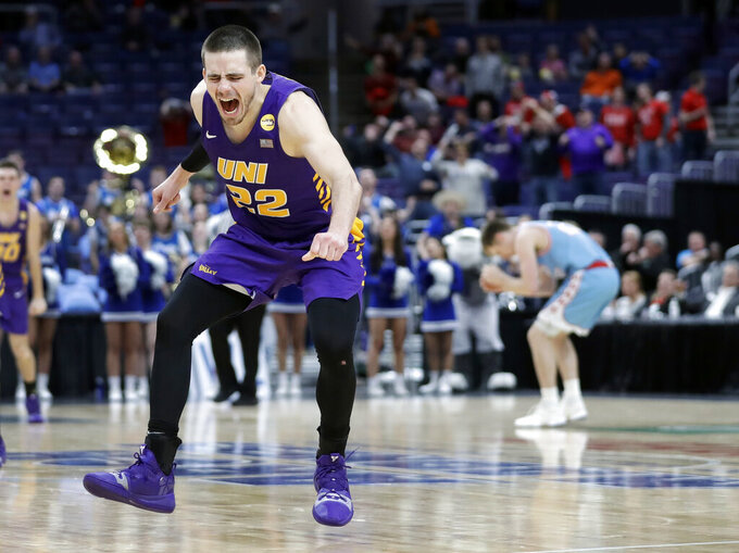 Northern Iowa's Wyatt Lohaus celebrates as the final horn sounds at the end of an NCAA college basketball game against Drake in the semifinal round of the Missouri Valley Conference tournament, Saturday, March 9, 2019, in St. Louis. Lohaus hit a basket with seconds left to give Northern Iowa a 60-58 victory. (AP Photo/Jeff Roberson)