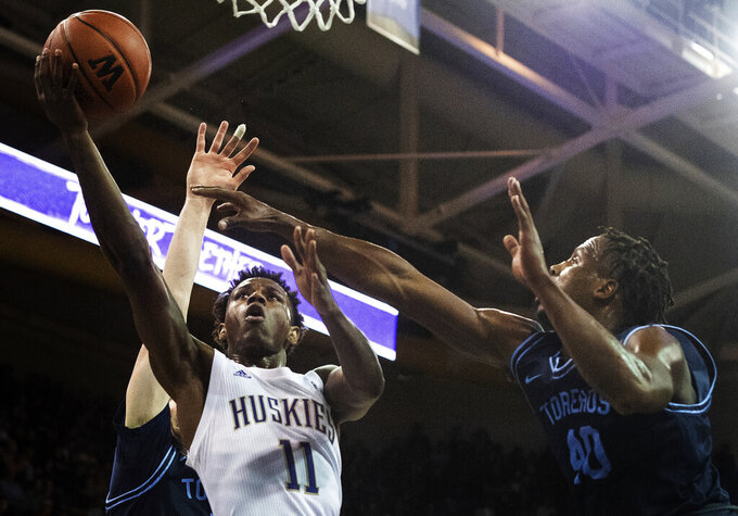 Stewart, McDaniels lead No. 25 Washington over USD 88-69