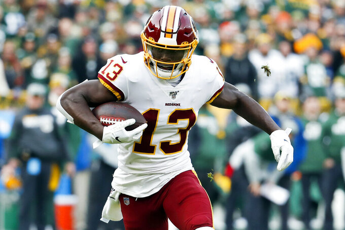 FILE - In this Sunday, Dec. 8, 2019, file photo, Washington Redskins' Kelvin Harmon runs during the first half of an NFL football game against the Green Bay Packers in Green Bay, Wis. Harmon caught 177 passes during his three seasons playing for N.C. State, but Harmon's biggest reception came last week during a small virtual ceremony. Harmon, who left school early after the 2018 football season, earned his degree in sports management and officially became an N.C. State graduate last week. (AP Photo/Matt Ludtke, File)
