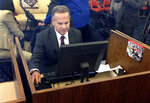FILE - In this March 26, 2018 photo, U.S. Rep. David Cicilline completes his census form on a computer at a library in Providence, R.I., during the nation's only test run of the 2020 Census. The U.S. Census Bureau is using new high-tech tools to help get an accurate population count next year as its facing criticism for the way it plans to reach out to people of color. (AP Photo/Michelle R. Smith,File)