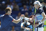 Casper Ruud, left, of Norway shakes hands at the net after his win over John Isner of the United States during their match at the ATP Cup in Perth, Australia, Friday, Jan. 3, 2020. (AP Photo/Trevor Collens)